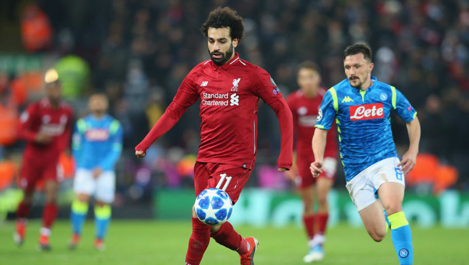 LIVERPOOL, ENGLAND - DECEMBER 11:  Mohamed Salah of Liverpool beats Mario Rui of SSC Napoli during the UEFA Champions League Group C match between Liverpool and SSC Napoli at Anfield on December 11, 2018 in Liverpool, United Kingdom.  (Photo by Alex Livesey - Danehouse/Getty Images)