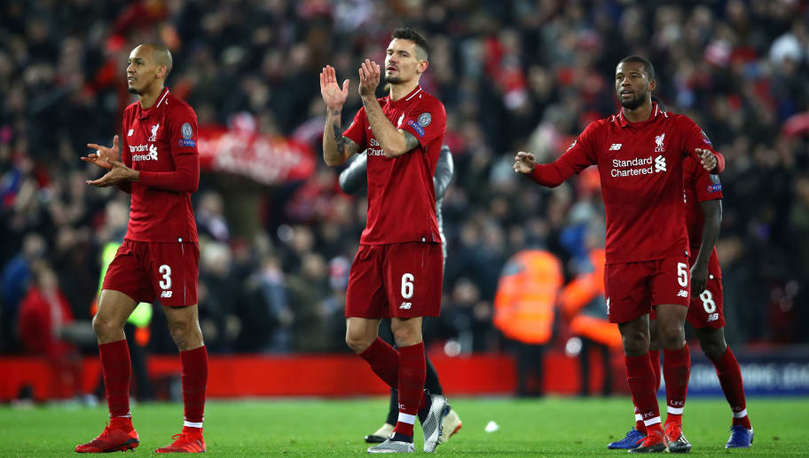 LIVERPOOL, ENGLAND - DECEMBER 11:  Fabinho, Dejan Lovren and Georginio Wijnaldum of Liverpool celebrate after the UEFA Champions League Group C match between Liverpool and SSC Napoli at Anfield on December 11, 2018 in Liverpool, United Kingdom.  (Photo by Clive Brunskill/Getty Images)