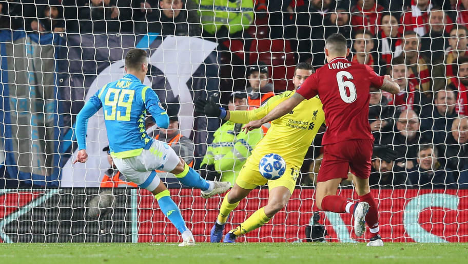 LIVERPOOL, ENGLAND - DECEMBER 11:  Alisson Becker of Liverpool makes a save from Arkadiusz Milik of SSC Napoli during the UEFA Champions League Group C match between Liverpool and SSC Napoli at Anfield on December 11, 2018 in Liverpool, United Kingdom.  (Photo by Alex Livesey - Danehouse/Getty Images)