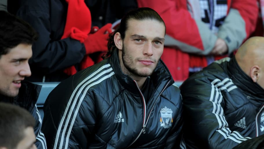 LIVERPOOL, ENGLAND - JANUARY 14: Andy Carroll of Liverpool looks on from the bench prior to the Barclays Premier League match between Liverpool and Stoke City at Anfield on January 14, 2012 in Liverpool, England. (Photo by Michael Regan/Getty Images)
