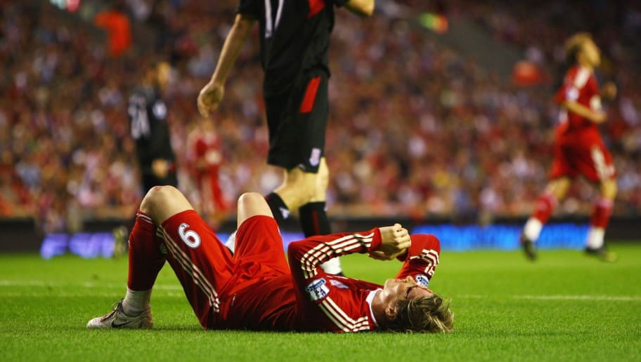 LIVERPOOL, ENGLAND - AUGUST 19:  Fernando Torres of Liverpool lies injured on the turf after clashing heads with Ryan Shawcross of Stoke City during the Barclays Premier League match between Liverpool and Stoke City at Anfield on August 19, 2009 in Liverpool, England.  (Photo by Clive Brunskill/Getty Images)