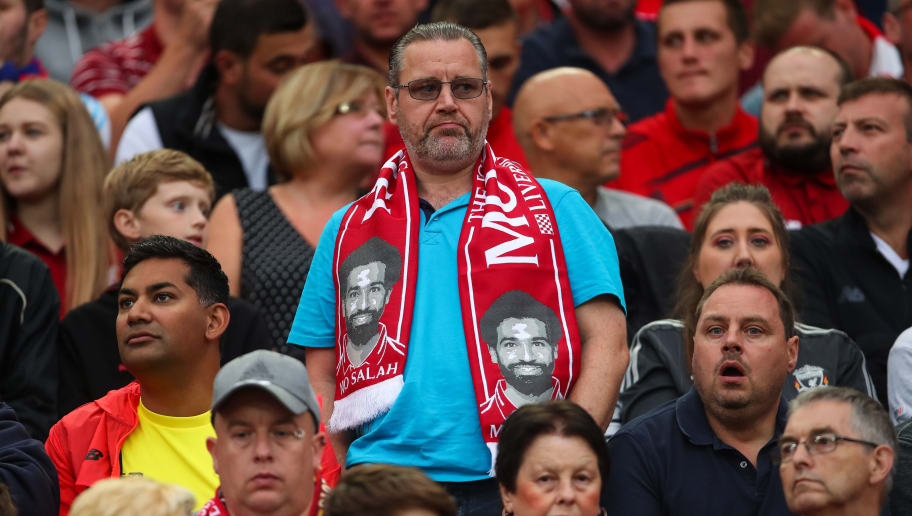 LIVERPOOL, ENGLAND - AUGUST 07: A fan of Liverpool wears a scarf with Mohamed Salah of Liverpool on during the pre-season friendly between Liverpool and Torino at Anfield on August 7, 2018 in Liverpool, England. (Photo by Robbie Jay Barratt - AMA/Getty Images)