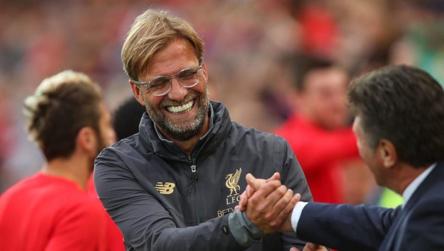 LIVERPOOL, ENGLAND - AUGUST 07: Jurgen Klopp manager / head coach of Liverpool and Walter Mazzarri head coach / manager of Torino during the pre-season friendly between Liverpool and Torino at Anfield on August 7, 2018 in Liverpool, England. (Photo by Robbie Jay Barratt - AMA/Getty Images)