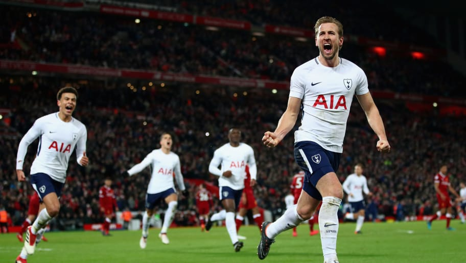 LIVERPOOL, ENGLAND - FEBRUARY 04:  Harry Kane of Tottenham Hotspur celebrates with team mates after scoring his sides second goal and his 100th Premier League goal  during the Premier League match between Liverpool and Tottenham Hotspur at Anfield on February 4, 2018 in Liverpool, England.  (Photo by Clive Brunskill/Getty Images)