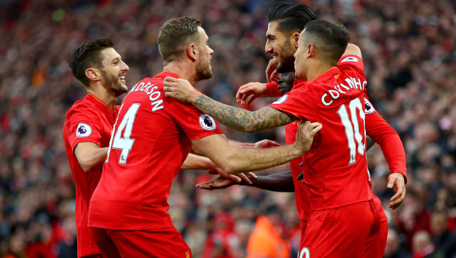 LIVERPOOL, ENGLAND - NOVEMBER 06: Emre Can of Liverpool celebrates scoring his sides third goal with team mates during the Premier League match between Liverpool and Watford at Anfield on November 6, 2016 in Liverpool, England.  (Photo by Clive Brunskill/Getty Images)