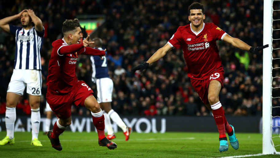 LIVERPOOL, ENGLAND - DECEMBER 13:  Dominic Solanke of Liverpool celebrates after scoring his sides first goal with Roberto Firmino of Liverpool but it is later disallowed during the Premier League match between Liverpool and West Bromwich Albion at Anfield on December 13, 2017 in Liverpool, England.  (Photo by Clive Brunskill/Getty Images)