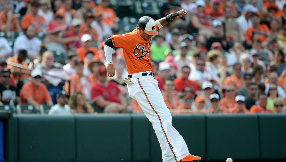 BALTIMORE, MD - JUNE 30:  Manny Machado #13 of the Baltimore Orioles jumps out of the way of a foul ball in the first inning against the Los Angeles Angels at Oriole Park at Camden Yards on June 30, 2018 in Baltimore, Maryland.  (Photo by Greg Fiume/Getty Images)
