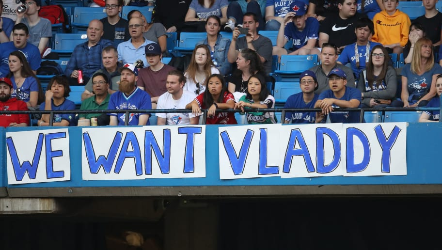 TORONTO, ON - MAY 23: Toronto Blue Jays fans hang a sign calling for  Vladimir Guerrero Jr. to be brought up to the big league club during MLB game action against the Los Angeles Angels of Anaheim at Rogers Centre on May 23, 2018 in Toronto, Canada. (Photo by Tom Szczerbowski/Getty Images) *** Local Caption *** Vladimir Guerrero Jr.