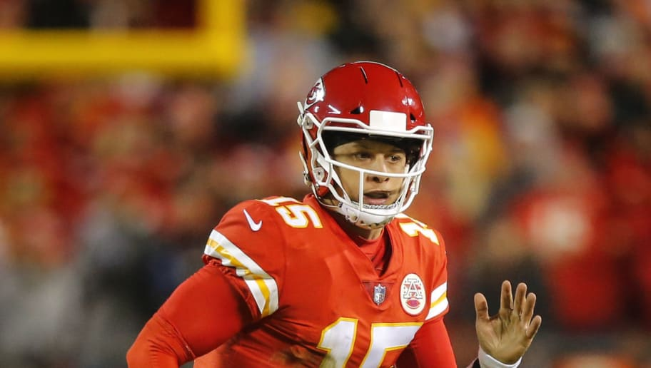 KANSAS CITY, MO - DECEMBER 13: Quarterback Patrick Mahomes #15 of the Kansas City Chiefs runs for yardage in the first quarter against the Los Angeles Chargers at Arrowhead Stadium on December 13, 2018 in Kansas City, Missouri. (Photo by David Eulitt/Getty Images)