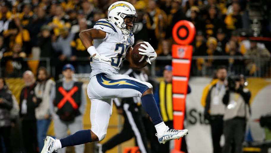 PITTSBURGH, PA - DECEMBER 02: Justin Jackson #32 of the Los Angeles Chargers jumps into the end zone for a 18 yard touchdown  in the fourth quarter during the game against the Pittsburgh Steelers at Heinz Field on December 2, 2018 in Pittsburgh, Pennsylvania. (Photo by Justin K. Aller/Getty Images)