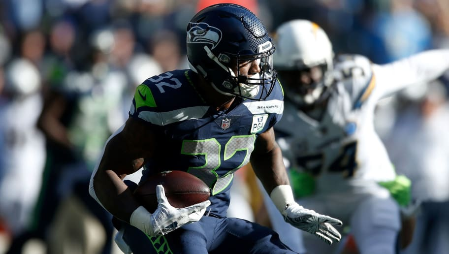 SEATTLE, WASHINGTON - NOVEMBER 04:  Chris Carson #32 of the Seattle Seahawks runs with the ball in the first quarter against the Los Angeles Chargers at CenturyLink Field on November 04, 2018 in Seattle, Washington. (Photo by Otto Greule Jr/Getty Images)