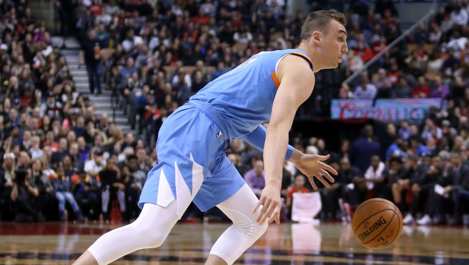 TORONTO, ON - MARCH 25:  Sam Dekker #7 of the Los Angeles Clippers dribbles the ball during the first half of an NBA game against the Toronto Raptors at Air Canada Centre on March 25, 2018 in Toronto, Canada.  NOTE TO USER: User expressly acknowledges and agrees that, by downloading and or using this photograph, User is consenting to the terms and conditions of the Getty Images License Agreement.  (Photo by Vaughn Ridley/Getty Images)