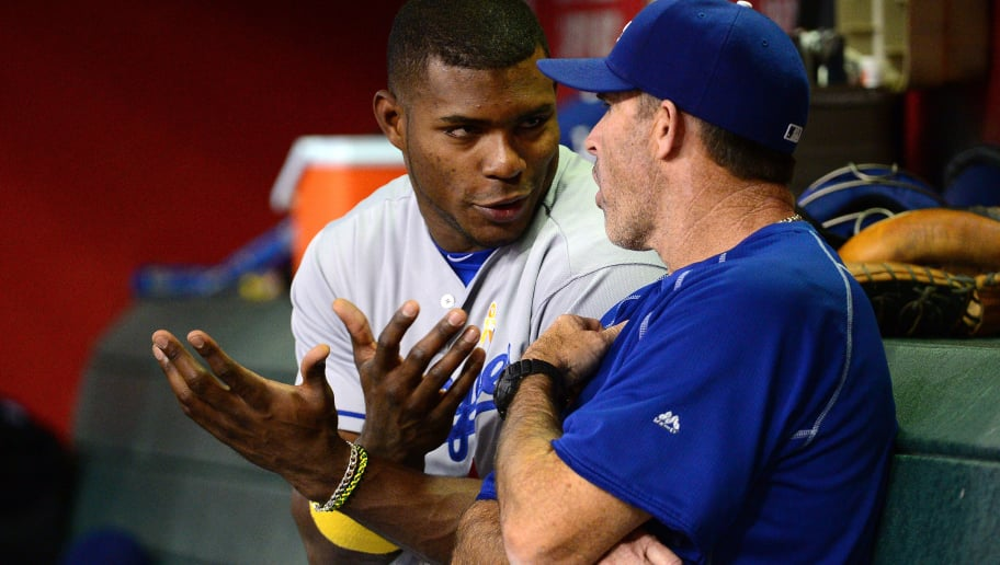 PHOENIX, AZ - SEPTEMBER 17:  Yasiel Puig #66 of the Los Angeles Dodgers talks with hitting coach Turner Ward #12 during the game against the Arizona Diamondbacks at Chase Field on September 17, 2016 in Phoenix, Arizona. The Dodgers won 6-2. (Photo by Jennifer Stewart/Getty Images)