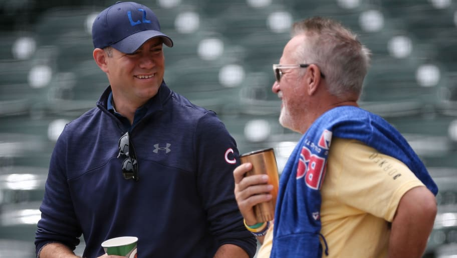 CHICAGO, IL - JUNE 20:  General manager Theo Epstein (L) and manager Joe Maddon of the Chicago Cubs meet before the game against the Los Angeles Dodgers at Wrigley Field on June 20, 2018 in Chicago, Illinois.  (Photo by Dylan Buell/Getty Images)