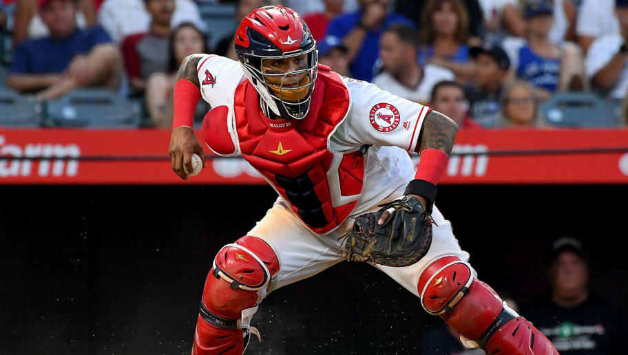 ANAHEIM, CA - JULY 08:  Martin Maldonado #12 of the Los Angeles Angels of Anaheim chases down a ball in the dirt during the game against the Los Angeles Dodgers at Angel Stadium on July 8, 2018 in Anaheim, California.  (Photo by Jayne Kamin-Oncea/Getty Images)