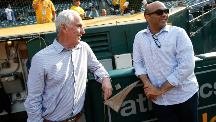 OAKLAND, CA - AUGUST 8: Broadcaster Ken Korach of the Oakland Athletics talks with General Manager Farhan Zaidi of the Los Angeles Dodgers on the field prior to the game at the Oakland Alameda Coliseum on August 8, 2018 in Oakland, California. The Athletics defeated the Dodgers 3-2. (Photo by Michael Zagaris/Oakland Athletics/Getty Images)