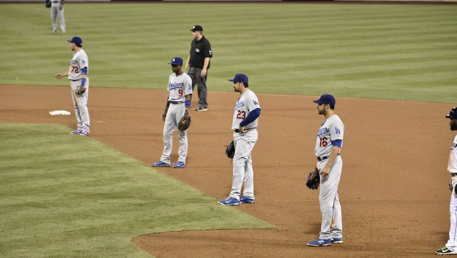 SAN DIEGO, CA - AUGUST 29:  Los Angeles Dodgers players line up using an extreme infield shift as Seth Smith #12 of the San Diego Padres comes up to bat during the twelfth inning of a baseball game at Petco Park August, 29, 2014 in San Diego, California.  (Photo by Denis Poroy/Getty Images)