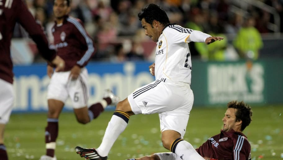 COMMERCE CITY, CO - MARCH 29:  Carlos Ruiz #20 of the Los Angeles Galaxy and John  DiRaimondo #28 of the Colorado Rapids get tangled up as they battle for the ball at Dick's Sporting Goods Park on March 29, 2008 in Commerce City, Colorado. The Rapids defeated the Galaxy 4-0.  (Photo by Doug Pensinger/Getty Images)