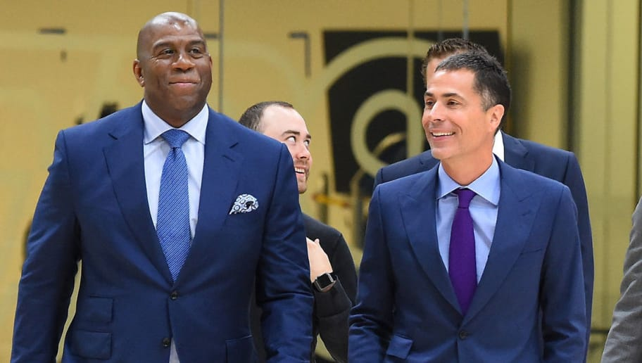 EL SEGUNDO, CA - JUNE 26:  President of basketball operations Magic Johnson, general manager Rob Pelinka, 2018 NBA draft picks, Moritz Wagner #9 and Sviatoslav Mykhailiuk #15 of the Los Angeles Lakers, enter the gym for a press conference at the UCLA Health Training Center on June 26, 2018 in El Segundo, California. Wagner was chosen with the 25th overall pick and Mykhailiuk with the 47th pick.  TO USER: User expressly acknowledges and agrees that, by downloading and/or using this Photograph, User is consenting to the terms and conditions of the Getty Images License Agreement.  (Photo by Jayne Kamin-Oncea/Getty Images)