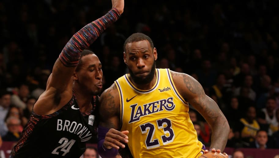 BROOKLYN, NY - DECEMBER 18:  (NEW YORK DAILIES OUT)    LeBron James #23 of the Los Angeles Lakers in action against Rondae Hollis-Jefferson #24 of the Brooklyn Nets at Barclays Center on December 18, 2018 in the Brooklyn borough of New York City.  The Nets defeated the Lakers 115-110. NOTE TO USER: User expressly acknowledges and agrees that, by downloading and/or using this photograph, user is consenting to the terms and conditions of the Getty Images License Agreement.  (Photo by Jim McIsaac/Getty Images)
