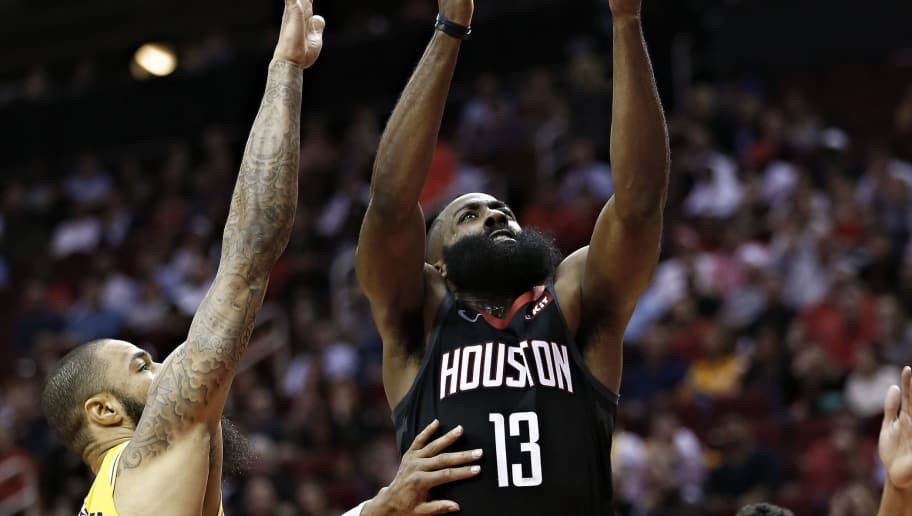 HOUSTON, TX - DECEMBER 13:  James Harden #13 of the Houston Rockets drives to basket between Tyson Chandler #5 of the Los Angeles Lakers nad Josh Hart #3 during the second quarter at Toyota Center on December 13, 2018 in Houston, Texas. NOTE TO USER: User expressly acknowledges and agrees that, by downloading and or using this photograph, User is consenting to the terms and conditions of the Getty Images License Agreement.  (Photo by Bob Levey/Getty Images)