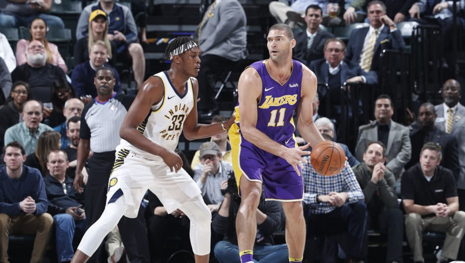 INDIANAPOLIS, IN - MARCH 19: Brook Lopez #11 of the Los Angeles Lakers looks to the basket while defended by Myles Turner #33 of the Indiana Pacers during a game at Bankers Life Fieldhouse on March 19, 2018 in Indianapolis, Indiana. The Pacers won 110-100. NOTE TO USER: User expressly acknowledges and agrees that, by downloading and or using the photograph, User is consenting to the terms and conditions of the Getty Images License Agreement. (Photo by Joe Robbins/Getty Images) *** Local Caption *** Brook Lopez;Myles Turner