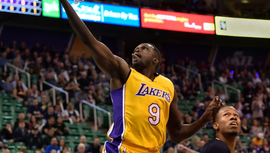 SALT LAKE CITY, UT - OCTOBER 28: Luol Deng #9 of the Los Angeles Lakers goes to the basket past the defense of Rodney Hood #5 of the Utah Jazz in the first half at Vivint Smart Home Arena on October 28, 2016 in Salt Lake City, Utah. NOTE TO USER: User expressly acknowledges and agrees that, by downloading and or using this photograph, User is consenting to the terms and conditions of the Getty Images License Agreement. (Photo by Gene Sweeney Jr/Getty Images)