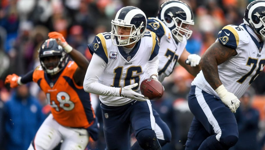 DENVER, CO - OCTOBER 14:  Quarterback Jared Goff #16 of the Los Angeles Rams sets to hand off against the Denver Broncos in the third quarter of a game at Broncos Stadium at Mile High on October 14, 2018 in Denver, Colorado. (Photo by Dustin Bradford/Getty Images)