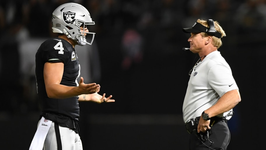 OAKLAND, CA - SEPTEMBER 10:  Derek Carr #4 of the Oakland Raiders speaks with head coach Jon Gruden during their NFL game against the Los Angeles Rams at Oakland-Alameda County Coliseum on September 10, 2018 in Oakland, California.  (Photo by Thearon W. Henderson/Getty Images)