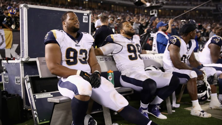 OAKLAND, CA - SEPTEMBER 10:  Ndamukong Suh #93 and Aaron Donald #99 of the Los Angeles Rams sit on the bench during their game against the Oakland Raiders at Oakland-Alameda County Coliseum on September 10, 2018 in Oakland, California.  (Photo by Ezra Shaw/Getty Images)