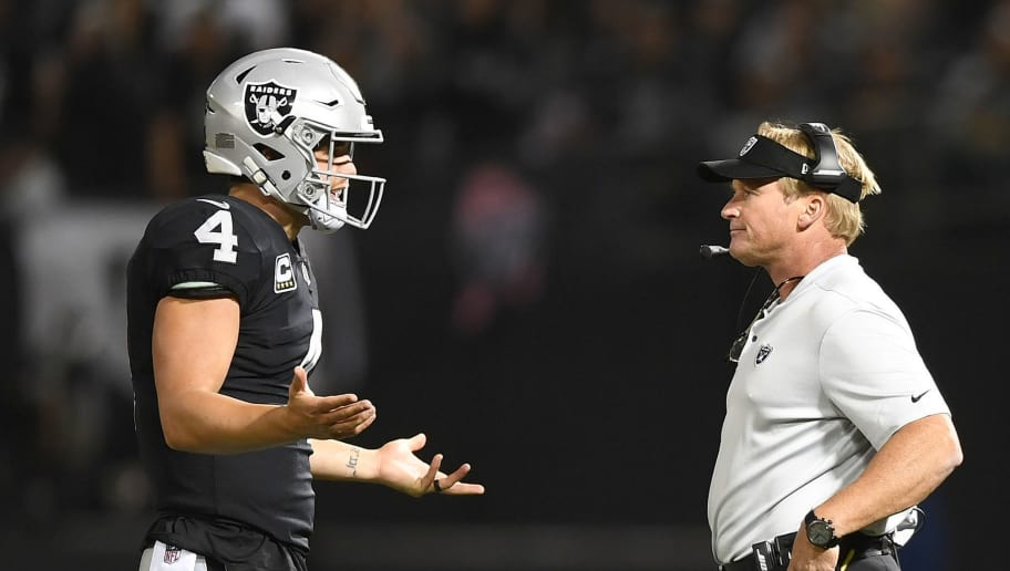 OAKLAND, CA - SEPTEMBER 10:  Derek Carr #4 of the Oakland Raiders speaks with head coach Jon Gruden in the first quarter during their NFL game against the Los Angeles Rams at Oakland-Alameda County Coliseum on September 10, 2018 in Oakland, California.  (Photo by Thearon W. Henderson/Getty Images)