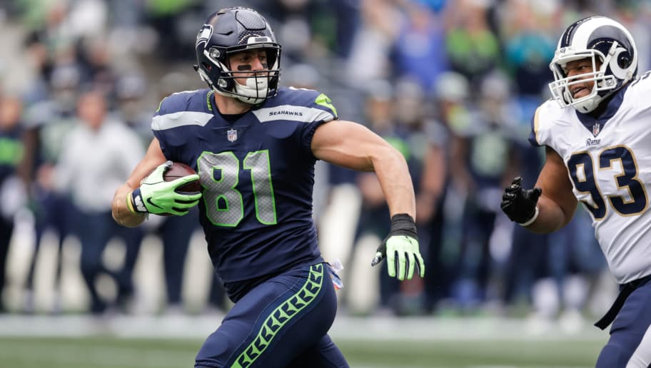 SEATTLE, WA - OCTOBER 07: Tight End Nick Vannett #81 of the Seattle Seahawks catches the ball in the first half against the Los Angeles Rams at CenturyLink Field on October 7, 2018 in Seattle, Washington. (Photo by Stephen Brashear/Getty Images)
