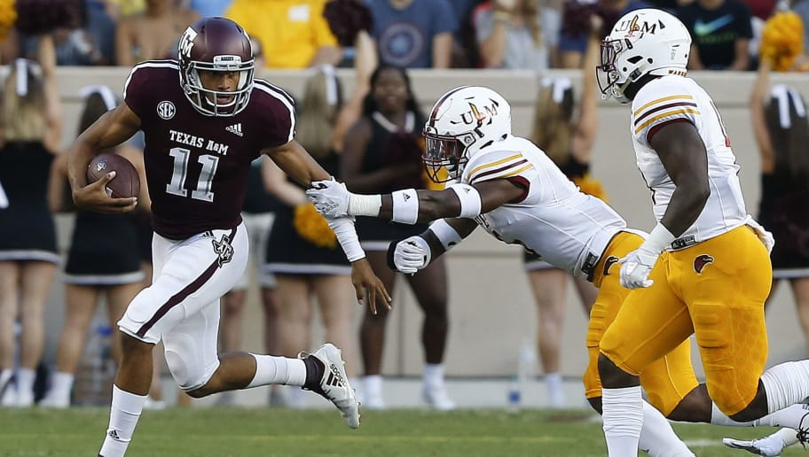COLLEGE STATION, TX - SEPTEMBER 15:  Kellen Mond #11 of the Texas A&M Aggies avoids the tackle of Wesley Thompson #6 of the Louisiana Monroe Warhawks in the first quarter at Kyle Field on September 15, 2018 in College Station, Texas.  (Photo by Bob Levey/Getty Images)