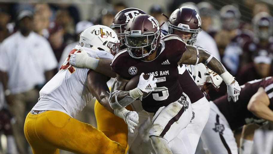 COLLEGE STATION, TX - SEPTEMBER 15:  Trayveon Williams #5 of the Texas A&M Aggies rushes past the Louisiana Monroe Warhawks defense in the first half at Kyle Field on September 15, 2018 in College Station, Texas.  (Photo by Bob Levey/Getty Images)