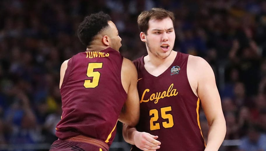 SAN ANTONIO, TX - MARCH 31: Marques Townes #5 and Cameron Krutwig #25 of the Loyola Ramblers react in the second half against the Michigan Wolverines during the 2018 NCAA Men's Final Four Semifinal at the Alamodome on March 31, 2018 in San Antonio, Texas.  (Photo by Tom Pennington/Getty Images)