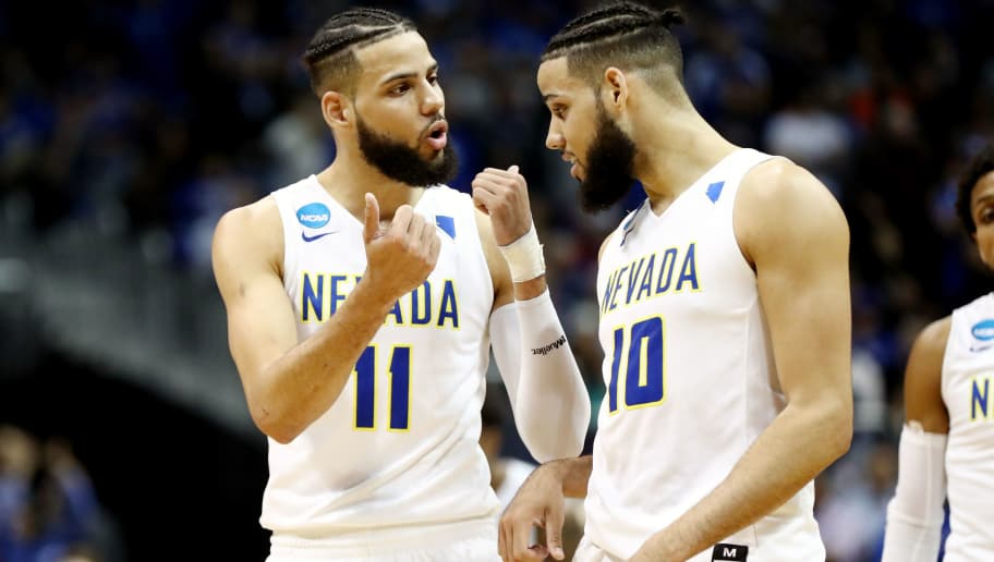ATLANTA, GA - MARCH 22: Cody Martin #11 and Caleb Martin #10 of the Nevada Wolf Pack discuss the play against the Loyola Ramblers in the second half during the 2018 NCAA Men's Basketball Tournament South Regional at Philips Arena on March 22, 2018 in Atlanta, Georgia. The Loyola Ramblers defeated the Nevada Wolf Pack 69-68.  (Photo by Ronald Martinez/Getty Images)