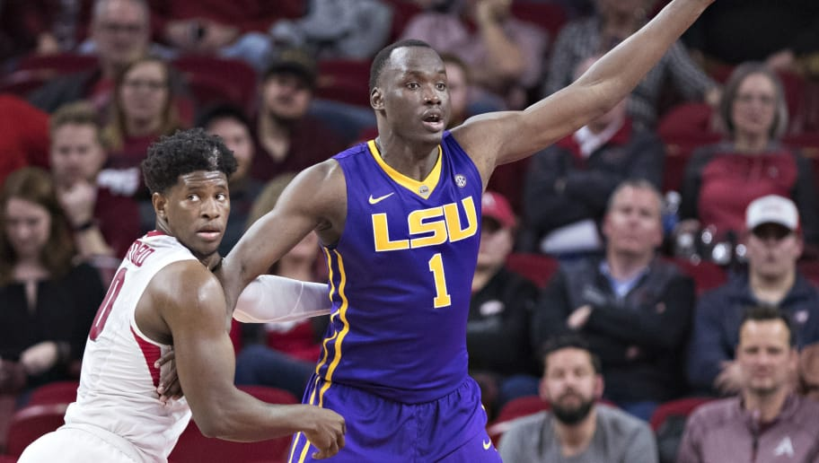 FAYETTEVILLE, AR - JANUARY 10:  Duop Reath #1 of the LSU Tigers looks for a pass while being defended by Jaylen Barford #0 of the Arkansas Razorbacks at Bud Walton Arena on January 10, 2018 in Fayetteville, Arkansas.  The Tigers defeated the Razorbacks 75-54.  (Photo by Wesley Hitt/Getty Images)
