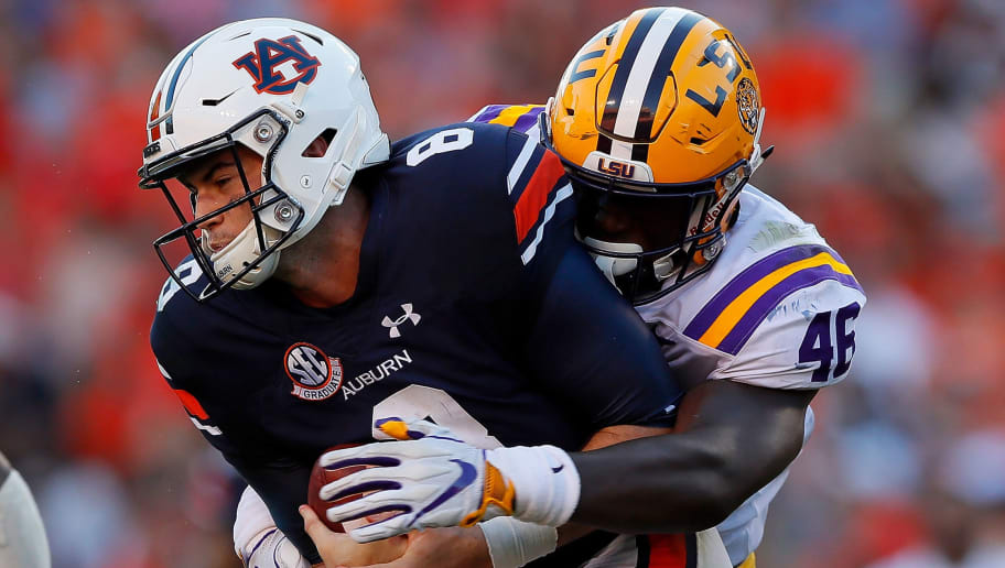AUBURN, AL - SEPTEMBER 15:  Andre Anthony #46 of the LSU Tigers tackles Jarrett Stidham #8 of the Auburn Tigers at Jordan-Hare Stadium on September 15, 2018 in Auburn, Alabama.  (Photo by Kevin C. Cox/Getty Images)