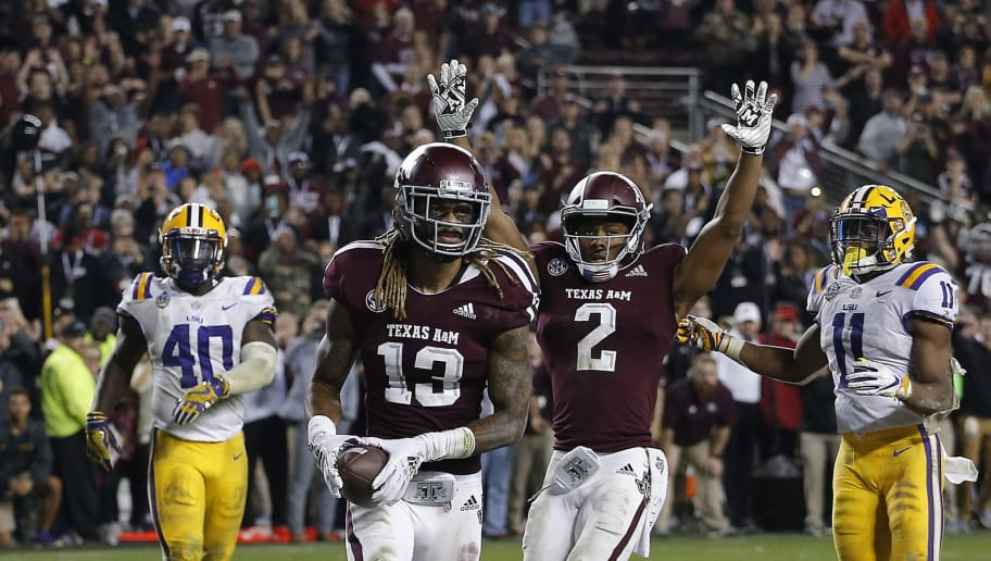 COLLEGE STATION, TEXAS - NOVEMBER 24: Kendrick Rogers #13 of the Texas A&M Aggies  scores  the winning two-point conversion in the seventh overtime period against the LSU Tigers as Jhamon Ausbon #2 celebrates as Devin White #40 of the LSU Tigers and Terrence Alexander #11 look on at Kyle Field on November 24, 2018 in College Station, Texas. (Photo by Bob Levey/Getty Images)