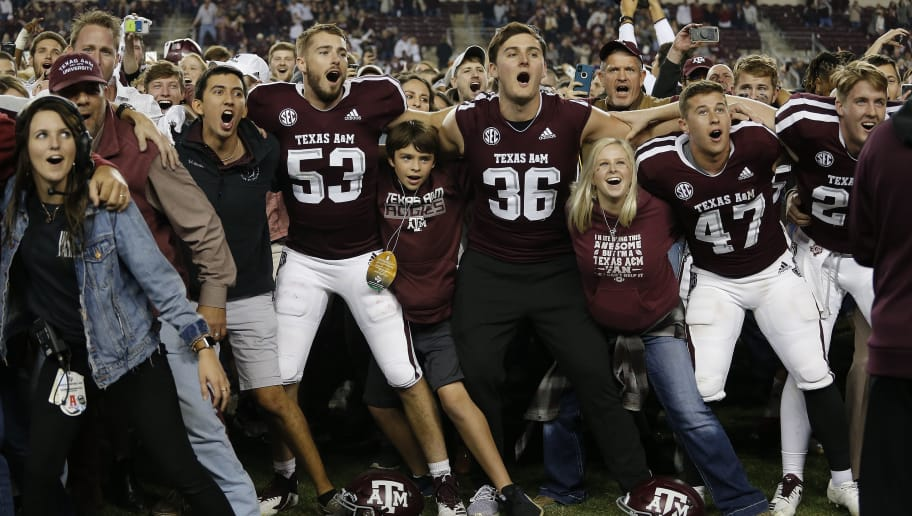 COLLEGE STATION, TX - NOVEMBER 24: Texas A&M players and students celebrate a win over the LSU Tigers at Kyle Field on November 24, 2018 in College Station, Texas. (Photo by Bob Levey/Getty Images)
