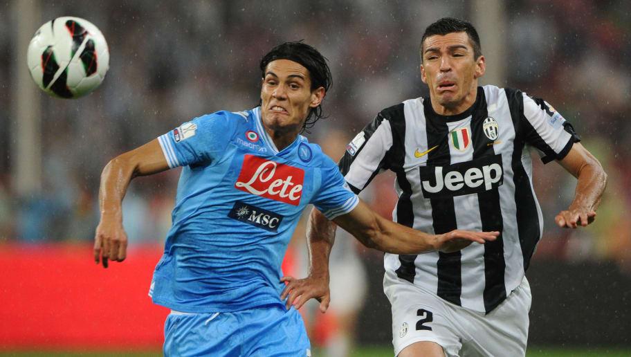 Lucio (R) of Juventus chases Edinson Cav