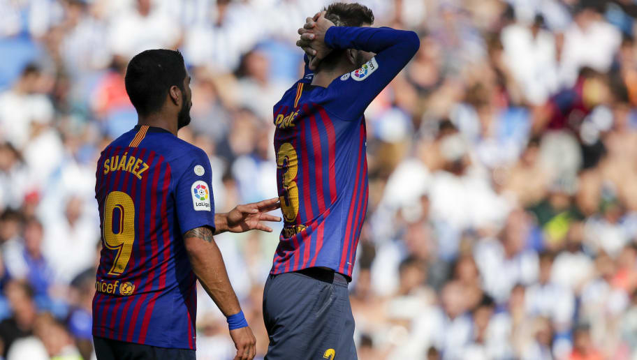 SAN SEBASTIAN, SPAIN - SEPTEMBER 15: Luis Alberto Suarez Diaz of FC Barcelona, Gerard Pique Bernabeu of FC Barcelona  during the La Liga Santander  match between Real Sociedad v FC Barcelona at the Estadio Anoeta on September 15, 2018 in San Sebastian Spain (Photo by David S. Bustamante/Soccrates/Getty Images)