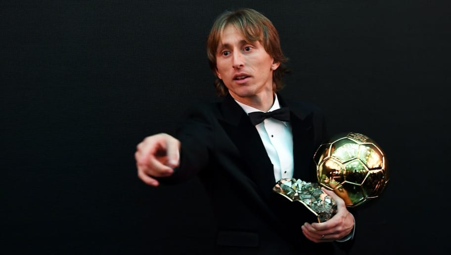 2018 Men's Ballon d'Or award for best player of the year's Real Madrid's Croatian midfielder Luka Modric poses with the trophy after the 2018  Ballon d'Or award ceremony at the Grand Palais in Paris on December 3, 2018. (Photo by FRANCK FIFE / AFP)        (Photo credit should read FRANCK FIFE/AFP/Getty Images)
