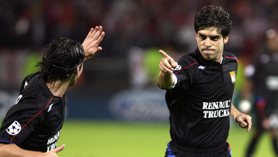 Lyon, FRANCE:  Lyon's Brazilian midfielder Juninho (R) jubilates with his Portuguese teammate Tiago after scoring a goal during the Champions League group F football match Lyon vs Olympiakos, 19 October 2005 at the Gerland stadium in Lyon. AFP PHOTO PHILIPPE MERLE  (Photo credit should read PHILIPPE MERLE/AFP/Getty Images)