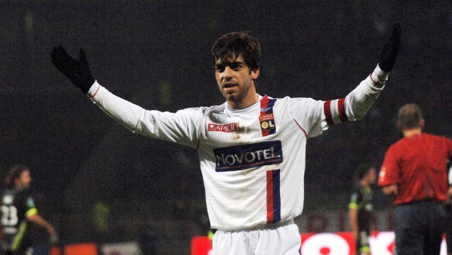 Lyon's Juninho reacts after scoring a go