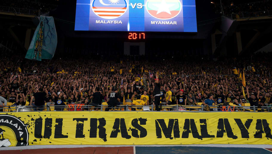 KUALA LUMPUR, MALAYSIA - NOVEMBER 24: Malaysian fans cheer during the 2018 AFF Suzuki Cup Group A match between Malaysia and Myanmar at the Bukit Jalil National Stadium on November 24, 2018 in Kuala Lumpur, Malaysia. (Photo by Allsport Co./Getty Images)