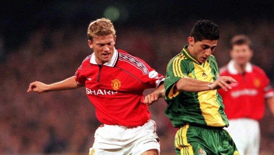 15 Jul 1999:  Simon Colosimo #2 for Australia leads Jesper Blomqvist #16 for Manchester United in action, during the match between Manchester United and the Australian Socceroos, played at the Melbourne Cricket Ground, Melbourne, Victoria, Australia. Mandatory Credit: Robert Cianflone/ALLSPORT