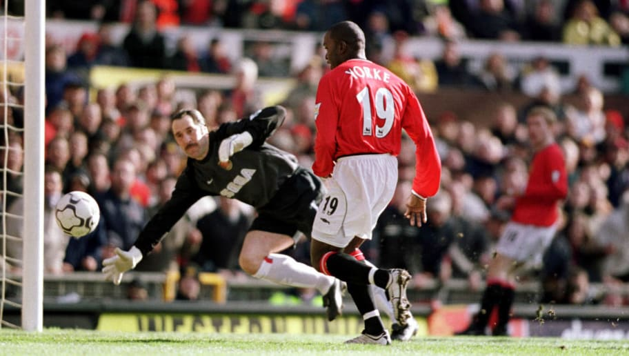 60ac1bbf1 25 Feb 2001  Dwight Yorke of Man Utd scores the first goal of the match. 23  Premier League games vs Arsenal