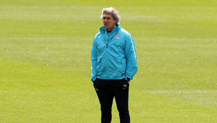 MANCHESTER, ENGLAND - MAY 03:  Manuel Pellegrini, Manager of Manchester City looks on during a training session ahead of the UEFA Champions League Semi Final Second Leg match between Real Madrid and Manchester City at the Academy Training Ground on May 3, 2016 in Manchester, England.  (Photo by Jan Kruger/Getty Images)
