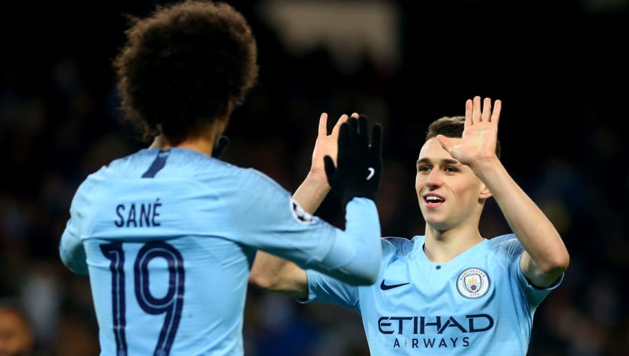 MANCHESTER, ENGLAND - DECEMBER 12: Leroy Sane of Manchester City celebrates scoring his second goal with Phil Foden of Manchester City during the UEFA Champions League Group F match between Manchester City and TSG 1899 Hoffenheim at Etihad Stadium on December 12, 2018 in Manchester, United Kingdom. (Photo by Chloe Knott - Danehouse/Getty Images)